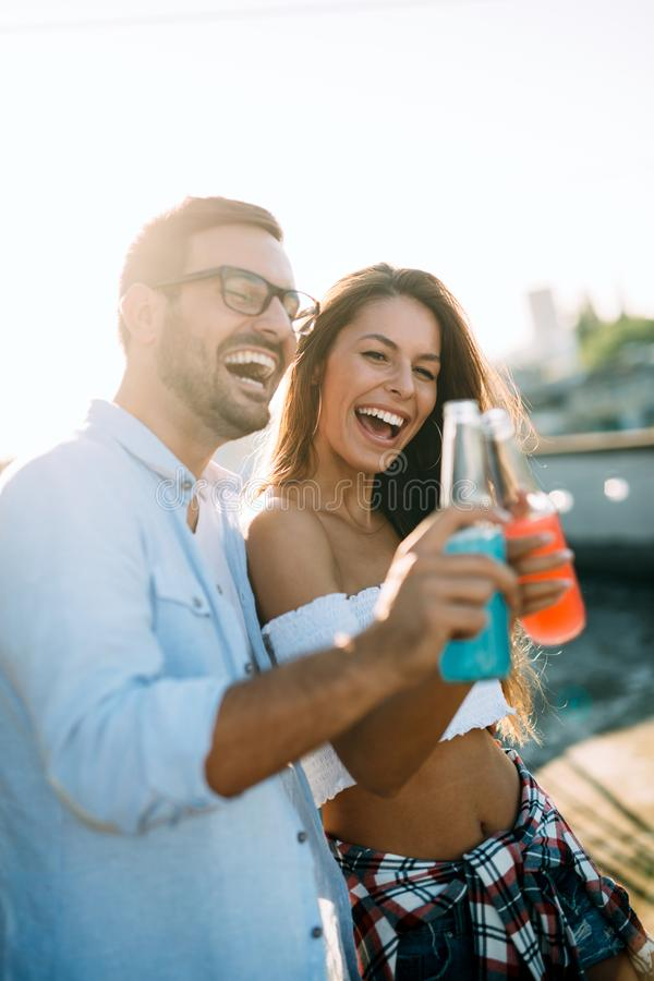 Happy young dancing couple having fun and enjoying party at summer royalty free stock photography
