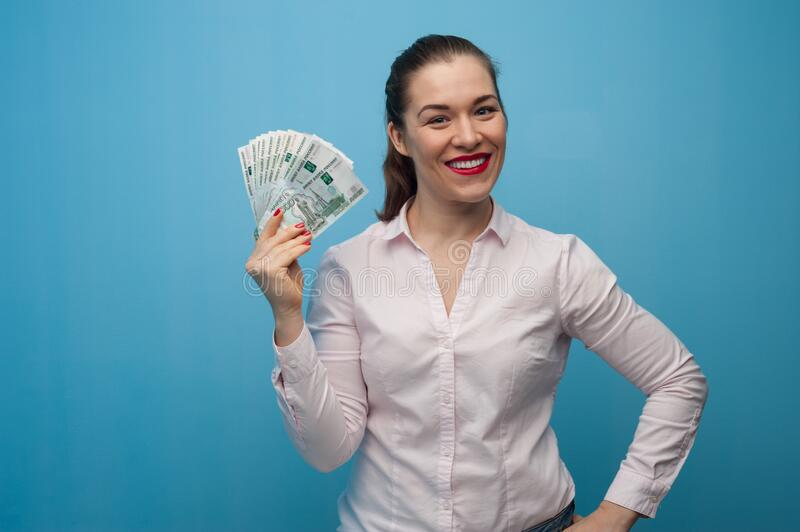 Happy young emotional caucasian woman with rubles royalty free stock photos