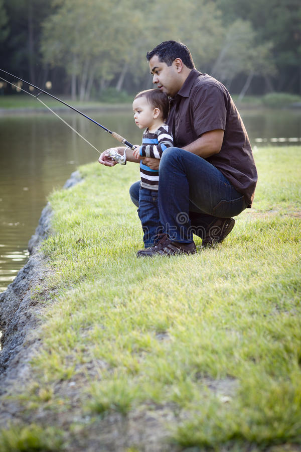 Happy Young Ethnic Father and Son Fishing royalty free stock photography