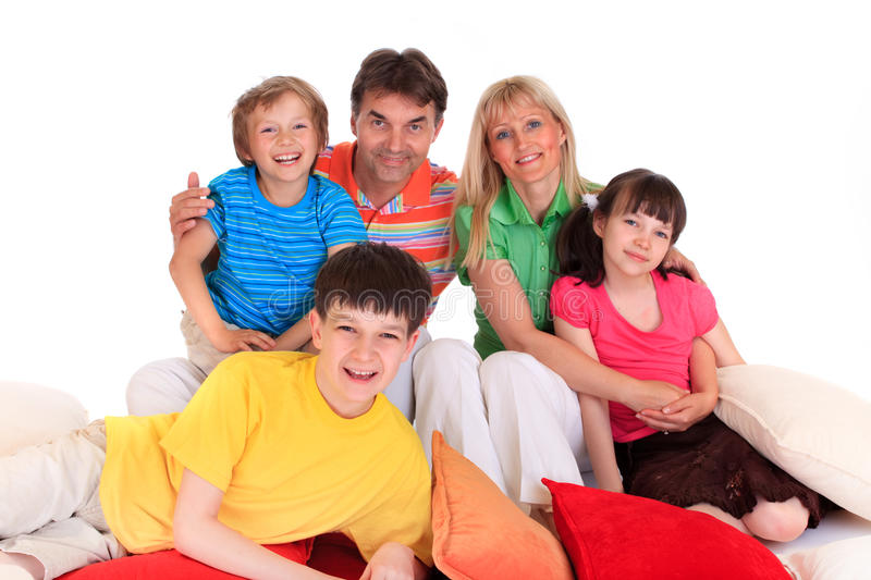 Happy young family. Close up of happy young family on bolster cushions, white background stock image