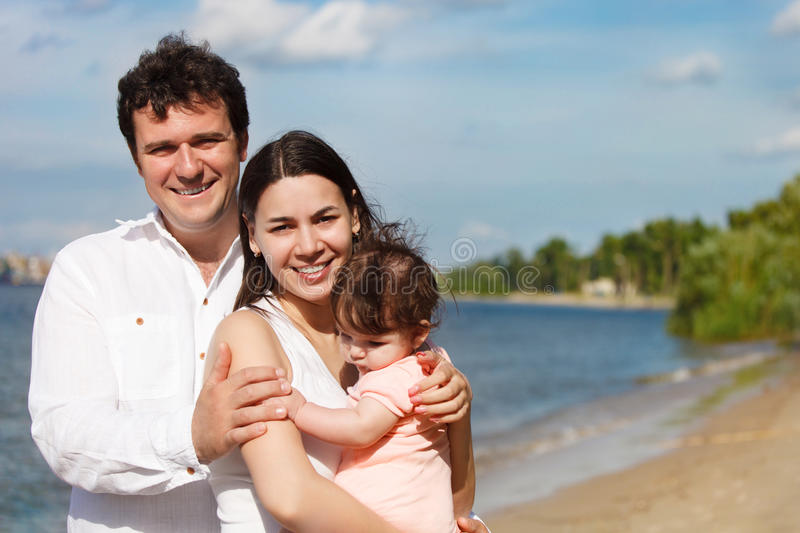 Happy Young Family With Baby Girl Stock Image