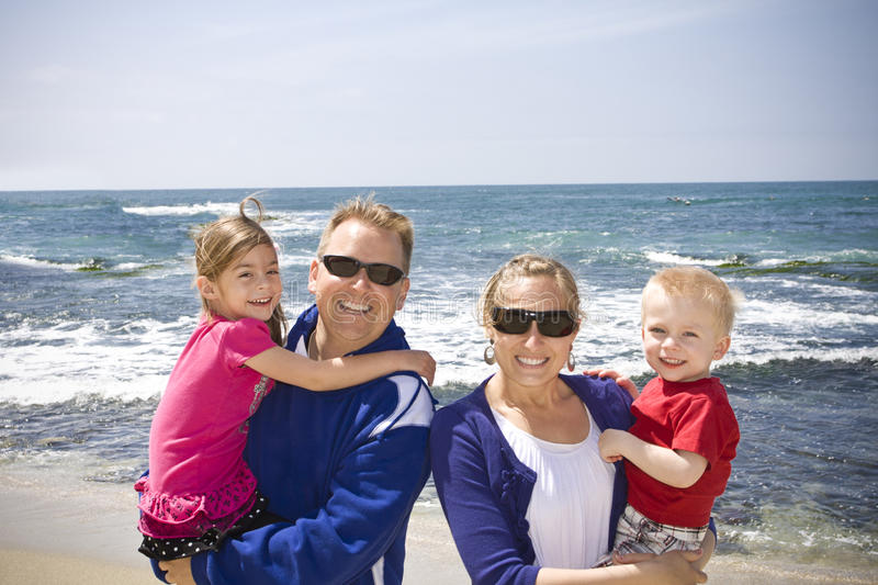Download Happy Young Family At The Beach Stock Image - Image: 19364415