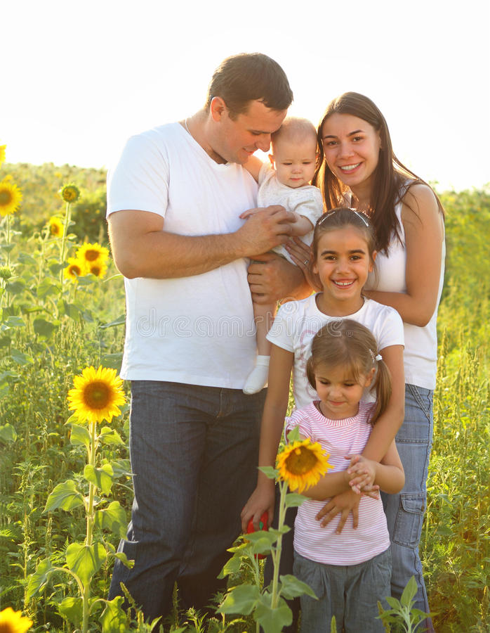 Happy young family with children royalty free stock photography
