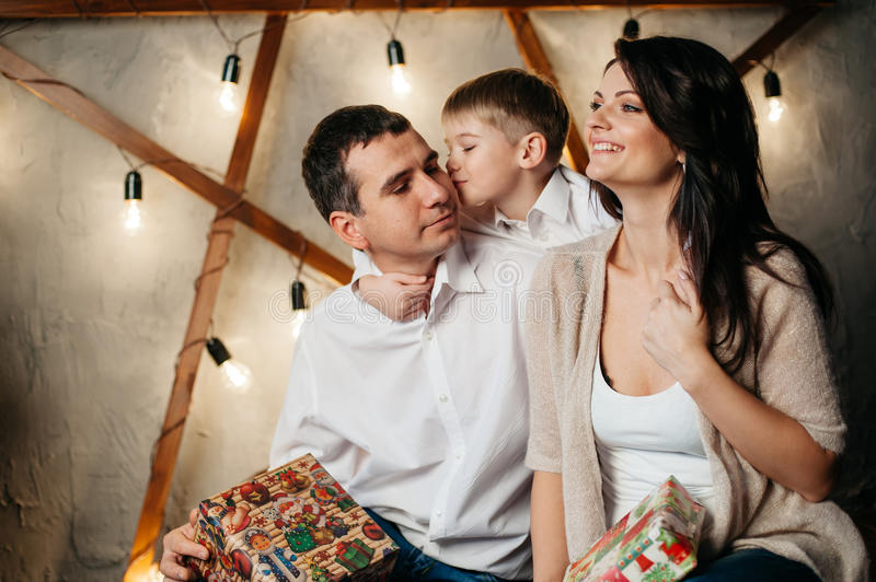 Happy young family in Christmas decorations royalty free stock photos