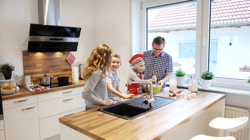 Happy young family cooking and having fun in the morning at kitchen stock photo