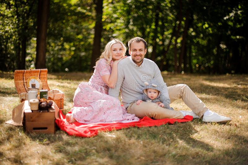 Happy young family with baby on the picnic stock images
