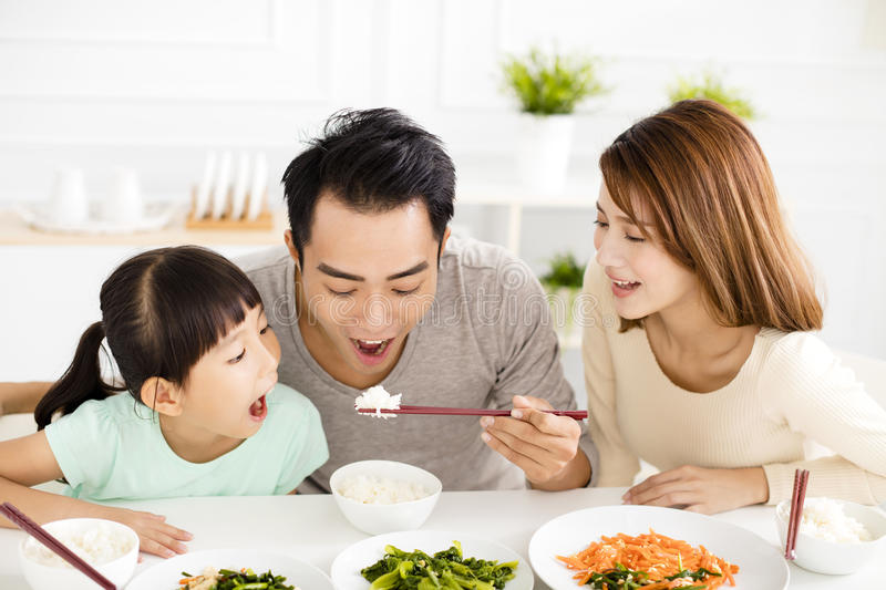 Happy young Family enjoy their lunch stock image