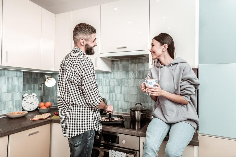 Happy young family feeling amazing cooking in the kitchen stock photo