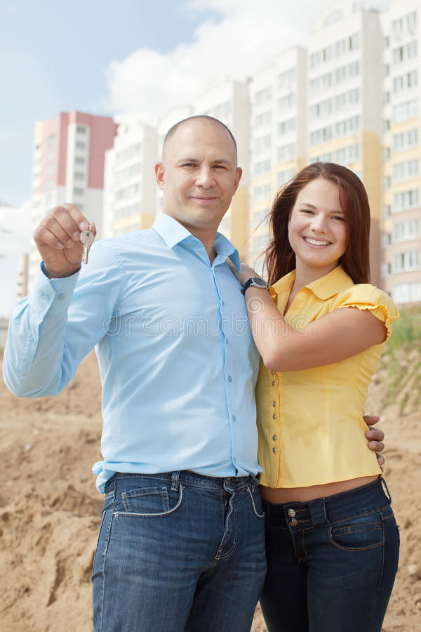 Happy young family in front of new home royalty free stock photos