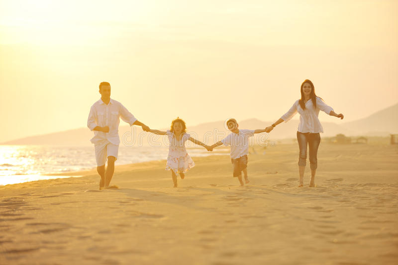Download Happy Young Family Have Fun On Beach At Sunset Stock Image - Image: 19709165
