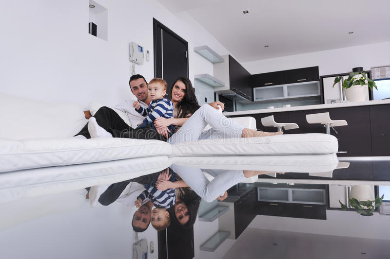 Happy young family have fun at home stock image
