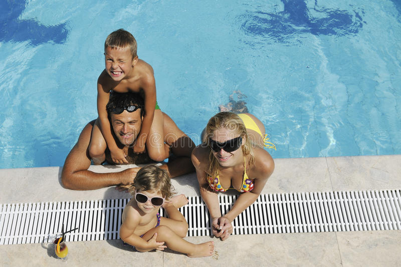 Download Happy Young Family Have Fun On Swimming Pool Royalty Free Stock Image - Image: 15628116