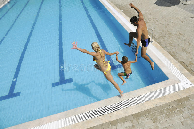 Download Happy Young Family Have Fun On Swimming Pool Stock Photo - Image: 15628164