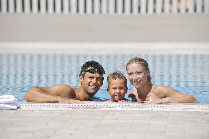 Download Happy Young Family Have Fun On Swimming Pool Stock Photo - Image: 15660176