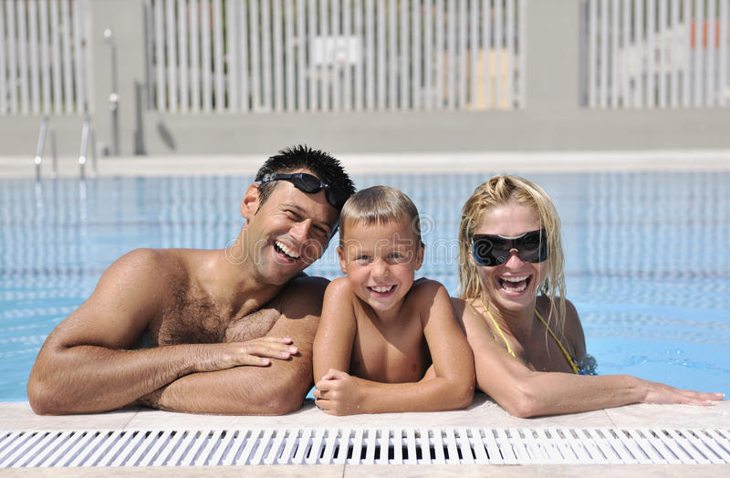 Download Happy Young Family Have Fun On Swimming Pool Stock Image - Image of healthy, family: 15660707