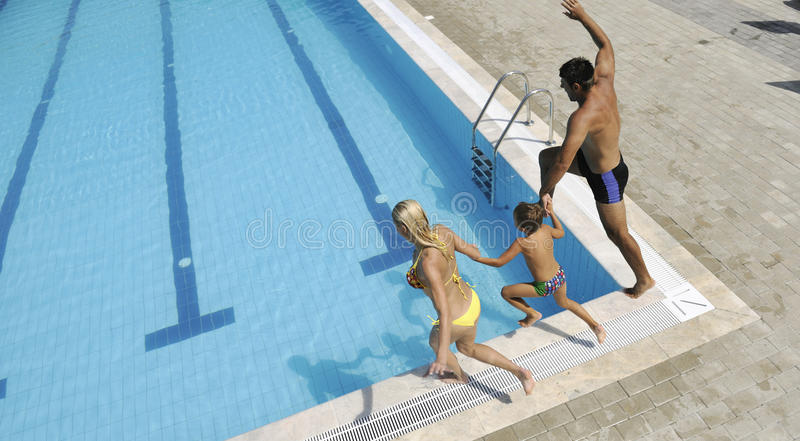 Download Happy Young Family Have Fun On Swimming Pool Stock Photo - Image: 15660890