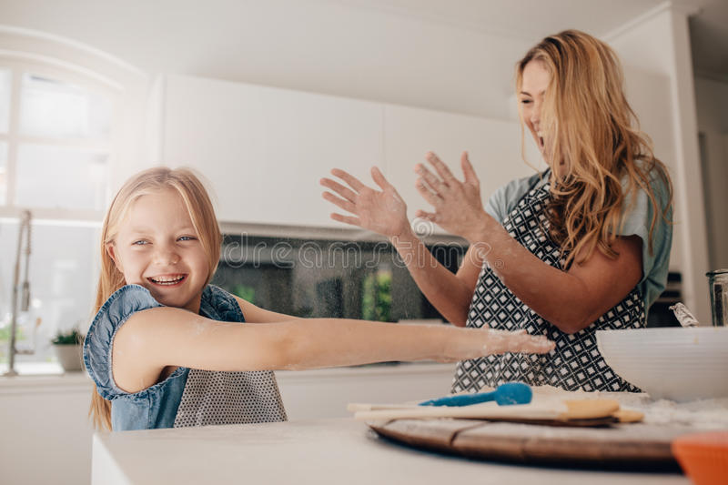 Happy young family having fun in kitchen stock photos
