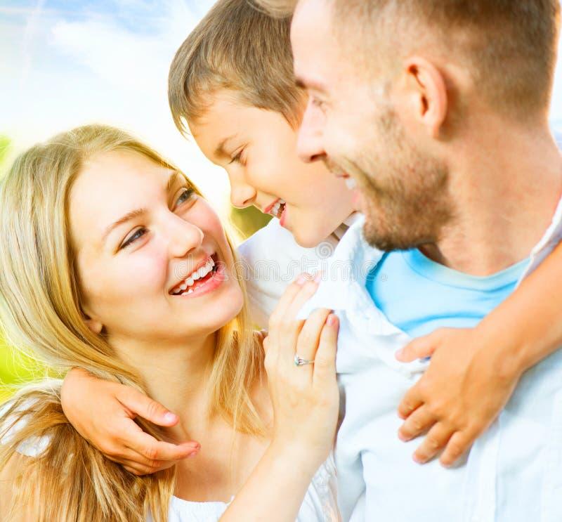 Happy young family having fun outdoors. Happy joyful young family having fun outdoors royalty free stock photo
