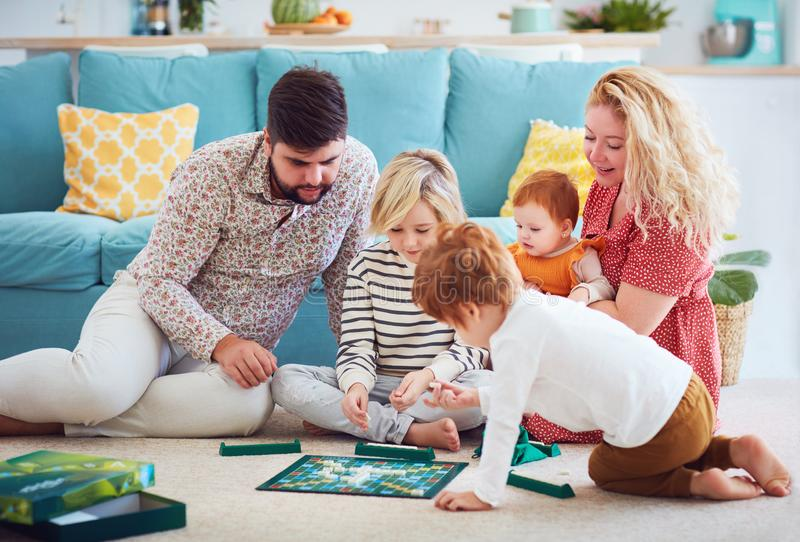 Happy family playing board games together at home royalty free stock photo