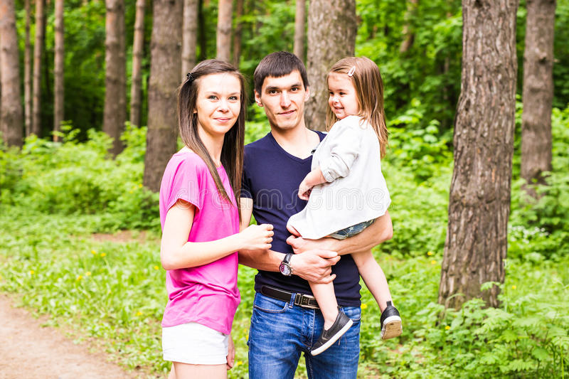 Happy young family spending time outdoor on a summer day royalty free stock photo