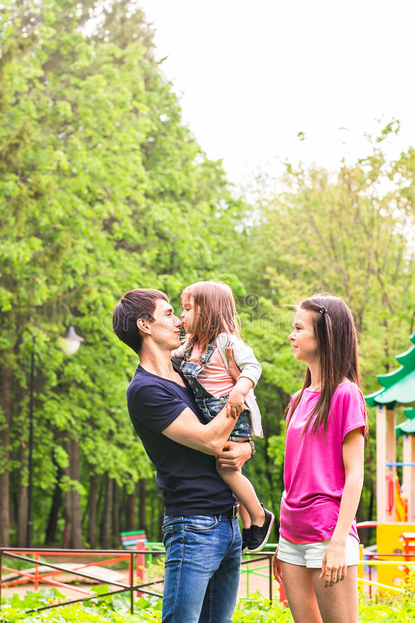 Happy young family spending time outdoor on a summer day stock images