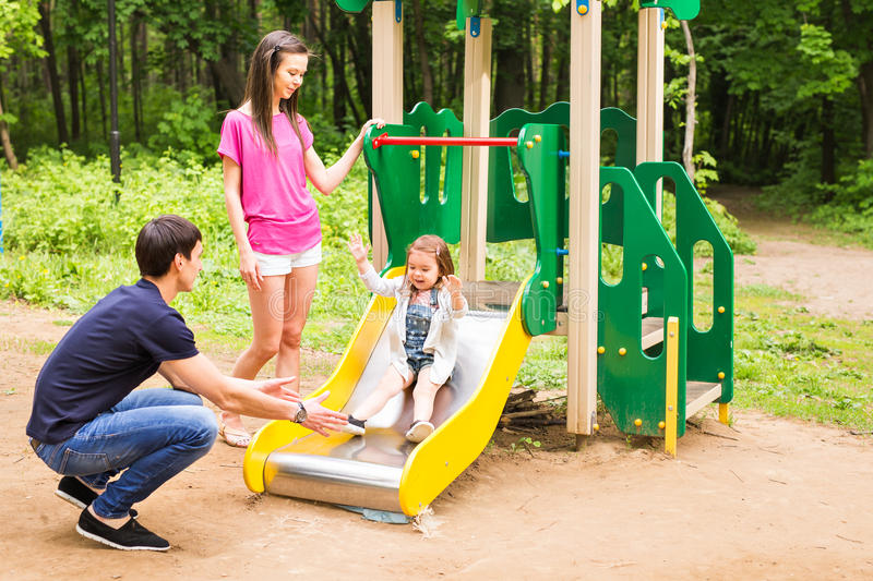 Happy young family spending time outdoor on a summer day royalty free stock images