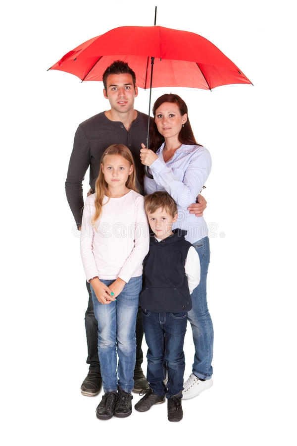 Download Happy Young Family Standing Under One Umbrella Stock Image - Image: 22297627