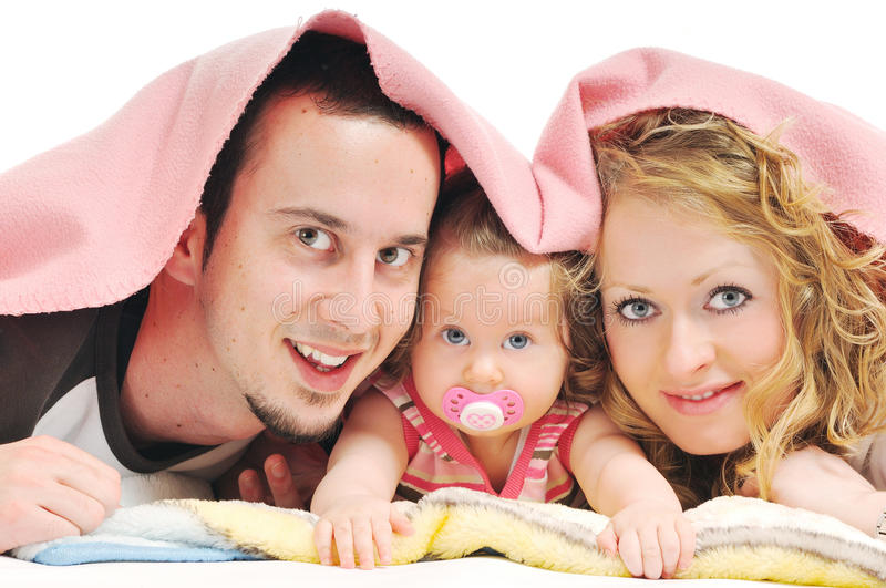 Happy young family together in studio royalty free stock image
