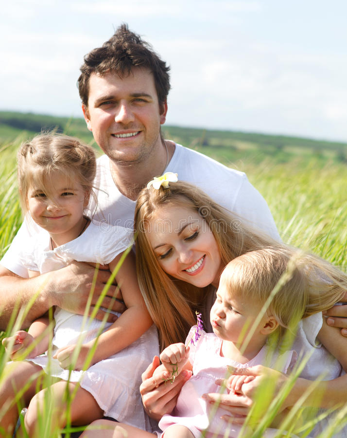 Happy young family with two children stock photos