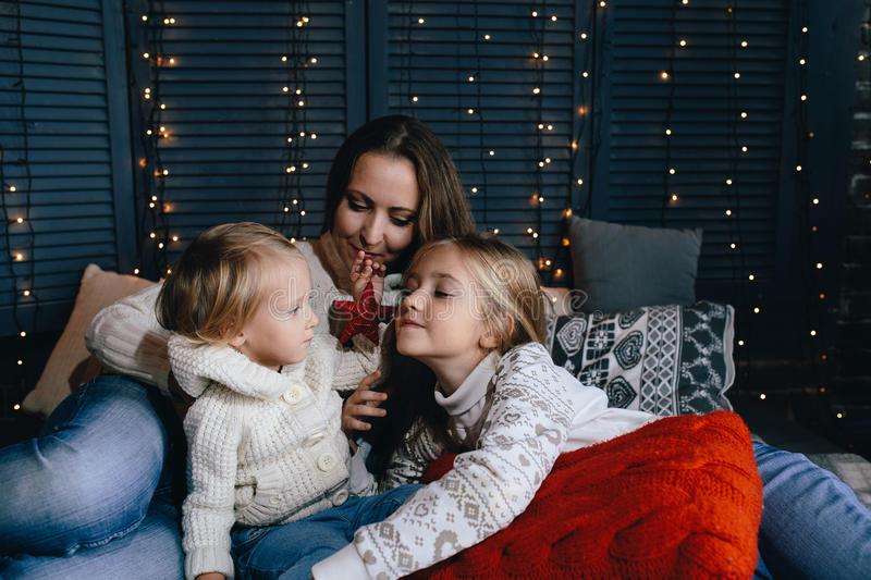 Happy young family in warm and cozy living room on winter day royalty free stock photography