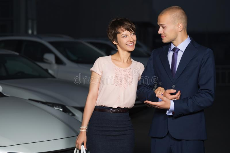 Happy young fashion couple in love walking on city street at night royalty free stock photography