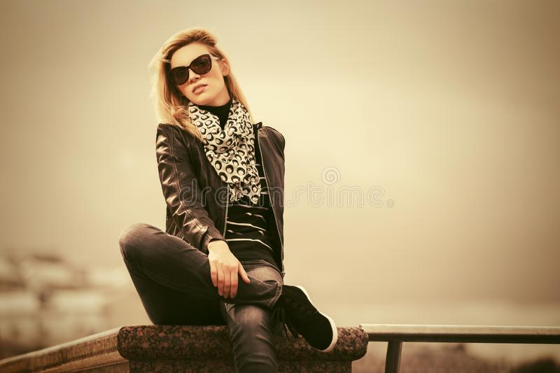 Happy young fashion woman in leather jacket royalty free stock image