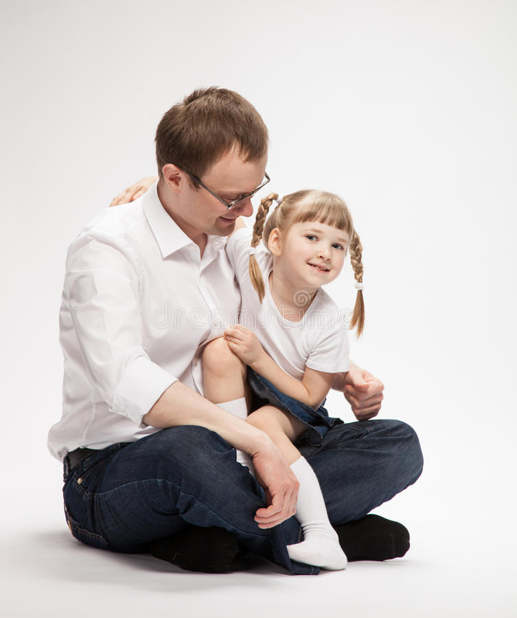 Happy young father with his smiling daughter royalty free stock image