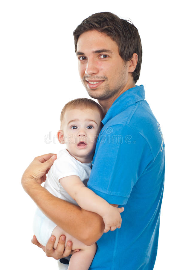 Happy young father holding baby boy stock photos