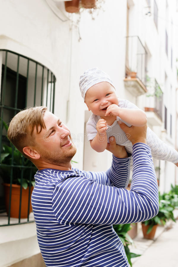 Happy and young father holding her baby. royalty free stock photos