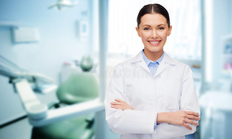 Happy young female dentist with tools. People, medicine, stomatology and healthcare concept - happy young female dentist with tools over medical office royalty free stock photos
