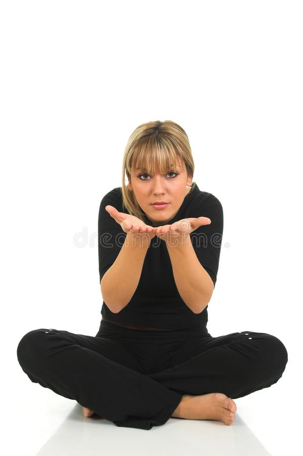 Happy young female sitting and blowing kisses from hands royalty free stock image