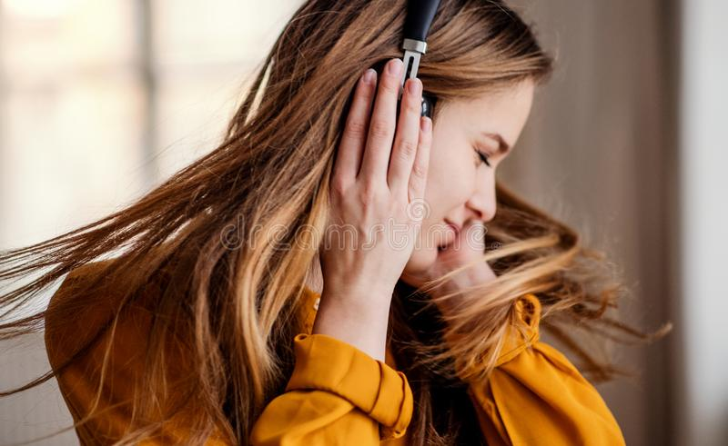 A young female student with headphones having fun. A happy young female student with headphones having fun stock photo