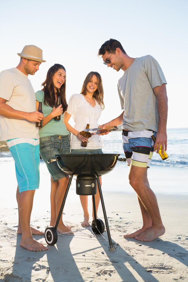 Happy Young Friends Having Barbecue Together Stock Photos