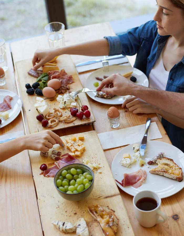 Happy young friends having breakfast stock photography