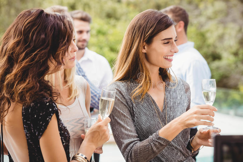 Happy young friends having drinks stock photography