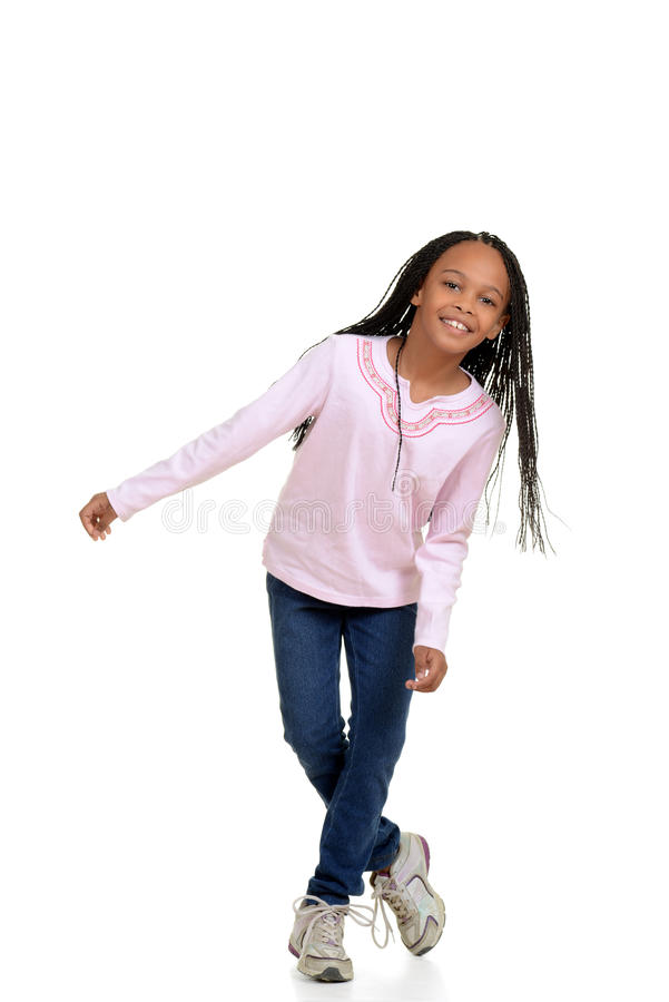 Happy young girl child dancing. With white background royalty free stock photography