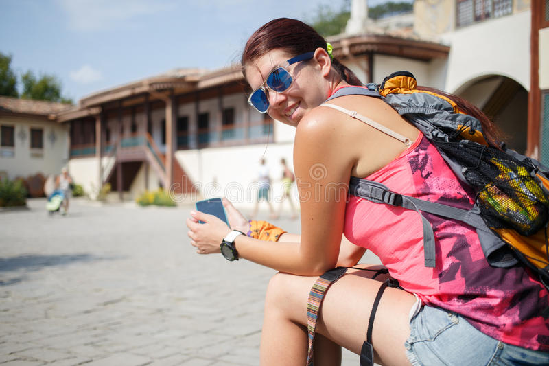 Happy young girl in courtyard stock photos