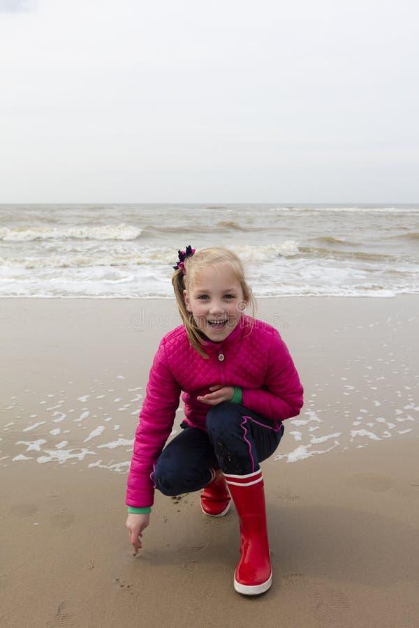 Happy Young Girl At Dutch North Sea Coast royalty free stock photo
