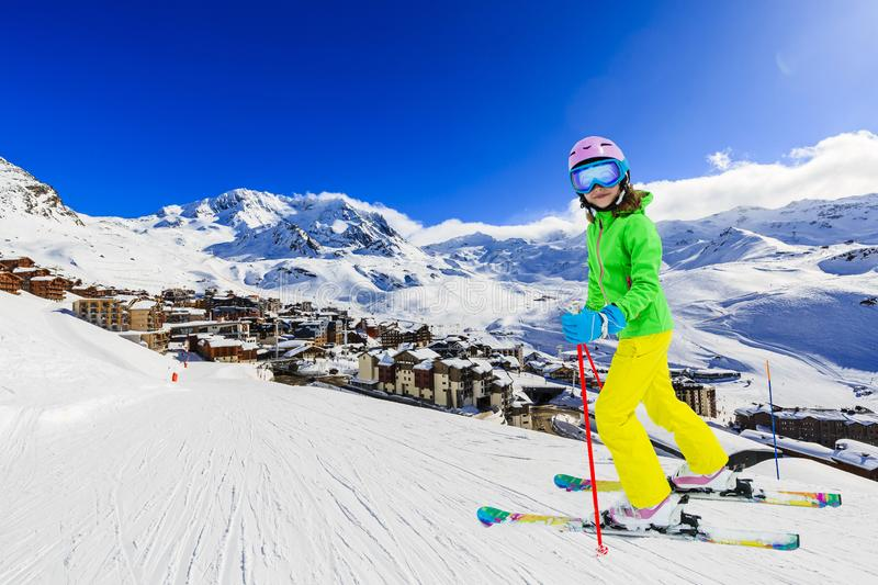Happy young girl enjoying winter vacations in mountains, Val Thorens, 3 Valleys, France. Playing with snow and sun in high stock image