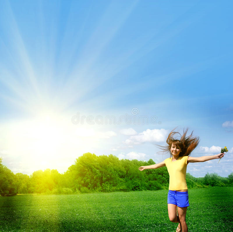 Happy young girl in the field royalty free stock image