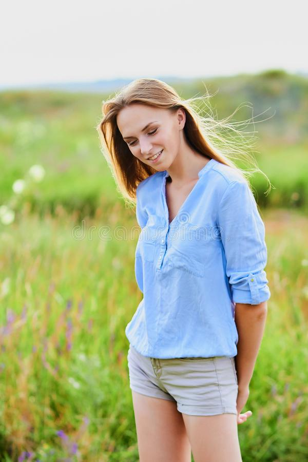Happy young girl in the field stock photography