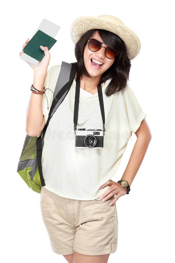 Happy young girl going on vacation. Portrait of happy young girl bring backpack, boarding pass and pasport royalty free stock image