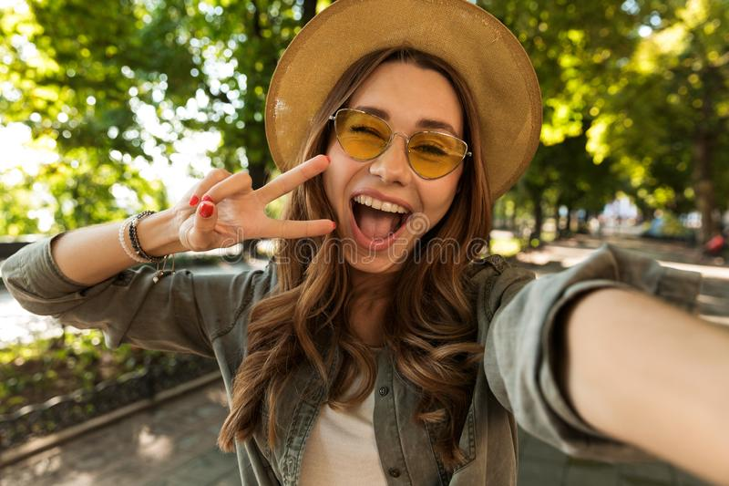 Happy young girl in hat royalty free stock photo