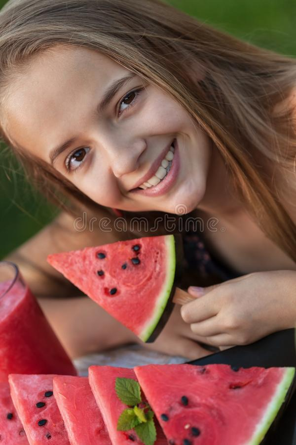 Happy young girl holding watermelon slice - portrait stock photography